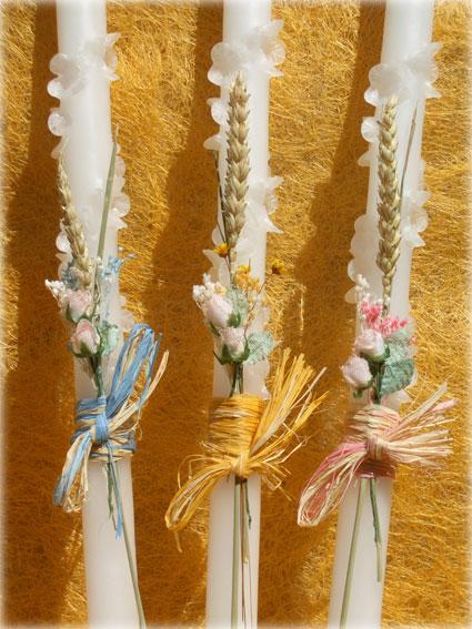 vela_de_bautizo_con_flores_y_cintas